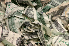 Crumpled Money. Pile of money stock photo