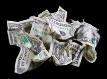 Crumpled money on black background. Crumpled money (cash) isolated on a black background. A ten and several one-dollar bills Stock Photos