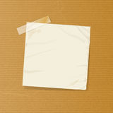 Crumpled note on brownpaper Royalty Free Stock Photo