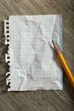 Crumpled notebook sheet and pencil Stock Photo