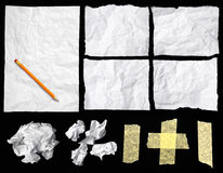 Crumpled notepaper. Pieces of crumpled notepaper isolated on black background stock images
