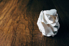 Crumpled office paper. On wooden table Stock Image