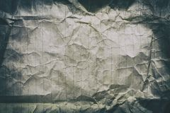 Crumpled old lined white paper. Sheet of old crumpled lined white paper with a vignette Stock Photos