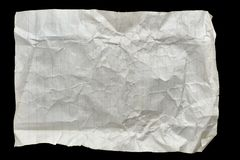 Crumpled old sheet of lined white paper. Sheet of old crumpled lined white paper isolated on a black background Royalty Free Stock Photo