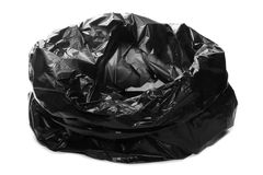 Crumpled, open black plastic garbage bag, isolated on white Royalty Free Stock Photo