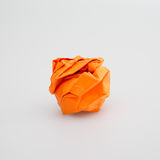 Crumpled orange paper ball isolated. White background Stock Images