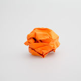 Crumpled orange paper ball isolated. White background Stock Photography