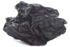 Crumpled Paper. Black crumpled tissue paper on white background royalty free stock image