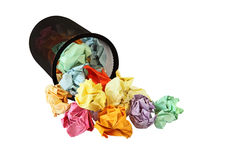 Crumpled Paper. Colorful crumpled office paper by the trash basket royalty free stock images