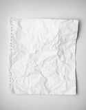 Crumpled paper. On a gray background royalty free stock image