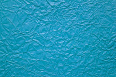 Crumpled paper background in blue color Royalty Free Stock Images