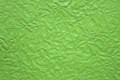 Crumpled paper background in green color Stock Image