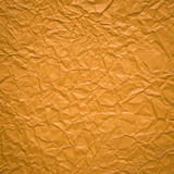 Crumpled paper background in orange color Stock Photography
