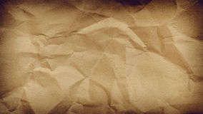 Crumpled paper background vignette space for text or image. Royalty Free Stock Image