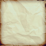 Crumpled paper background vignette space for text or image. Royalty Free Stock Photography