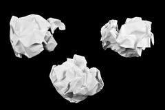 Crumpled paper ball. Isolated on a black background stock photography