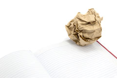 Crumpled paper ball and book Royalty Free Stock Photography