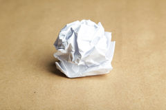 Crumpled paper ball on brown background. Crumpled paper ball on brown background Royalty Free Stock Photography