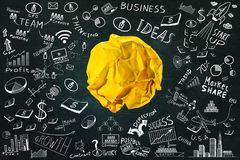 Crumpled paper ball with business doodles set.ideas concept Royalty Free Stock Photography