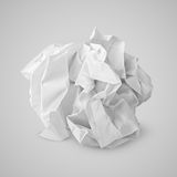 Crumpled paper ball on gray Stock Photo