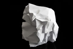 Crumpled paper ball isolated. On a black background Royalty Free Stock Photo