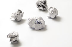 Crumpled paper ball. White crumpled paper ball focus idea word on a white background Royalty Free Stock Photography