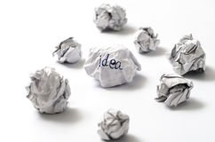 Crumpled paper ball. White crumpled paper ball focus idea word on a white background Royalty Free Stock Photo