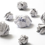 Crumpled paper ball. White crumpled paper ball focus idea word on a white background Royalty Free Stock Image