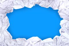 Crumpled paper ball white frame on blue screen color and copy space background, copy space in rough paper waste ball on blue stock photo