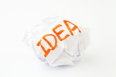 Crumpled paper ball with word idea. Over white background Royalty Free Stock Photos