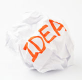 Crumpled paper ball with word idea. In red color Royalty Free Stock Images