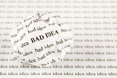 Crumpled paper ball with words bad idea Royalty Free Stock Photography