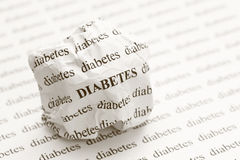 Crumpled paper ball with words diabetes Stock Photo