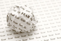Crumpled paper ball with words fear Stock Images