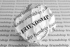Crumpled paper ball with words Friendship Stock Images