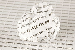 Crumpled paper ball with words Game Over Royalty Free Stock Images
