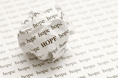 Crumpled paper ball with words hope Stock Photography