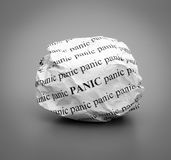 Crumpled paper ball with words Panic on gray background Royalty Free Stock Photos
