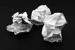 Crumpled paper balls. On dark background Royalty Free Stock Photography
