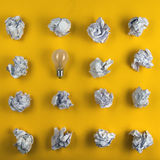 Crumpled paper balls and blank sheet of paper with pencil on yellow background. Paper wad. Creativity problems Royalty Free Stock Image