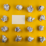 Crumpled paper balls and blank sheet of paper with pencil on yellow background. Paper wad. Creativity problems Royalty Free Stock Images