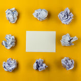 Crumpled paper balls and blank sheet of paper with pencil on yellow background. Paper wad. Creativity problems Stock Photos