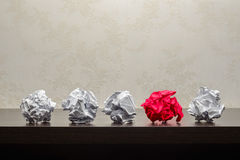 Crumpled Paper Balls. Five crumpled paper balls on a dark wooden table. Research or creative process concept stock images