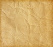Crumpled paper. Beige paper surface stock image