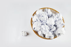 Crumpled paper in a bin. On white background Stock Images