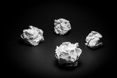Crumpled paper on black background.  Stock Image