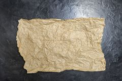 Crumpled paper on a black background. Place for your text. stock photo