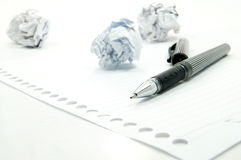Crumpled paper and black pen. On white background Royalty Free Stock Images