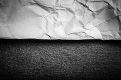 Crumpled paper on black slate cutting board. Toned Royalty Free Stock Photo