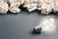Crumpled paper and Bulb Glowing Stock Photo